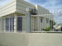 Cordova-house-262-barbed-wire-fence
